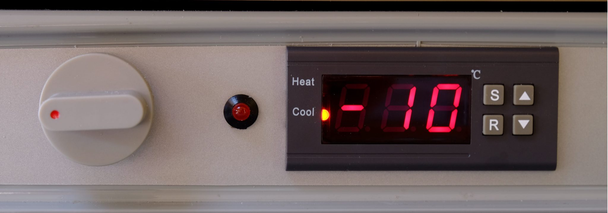 Digital heat/cool controller installed next to the original thermostat.