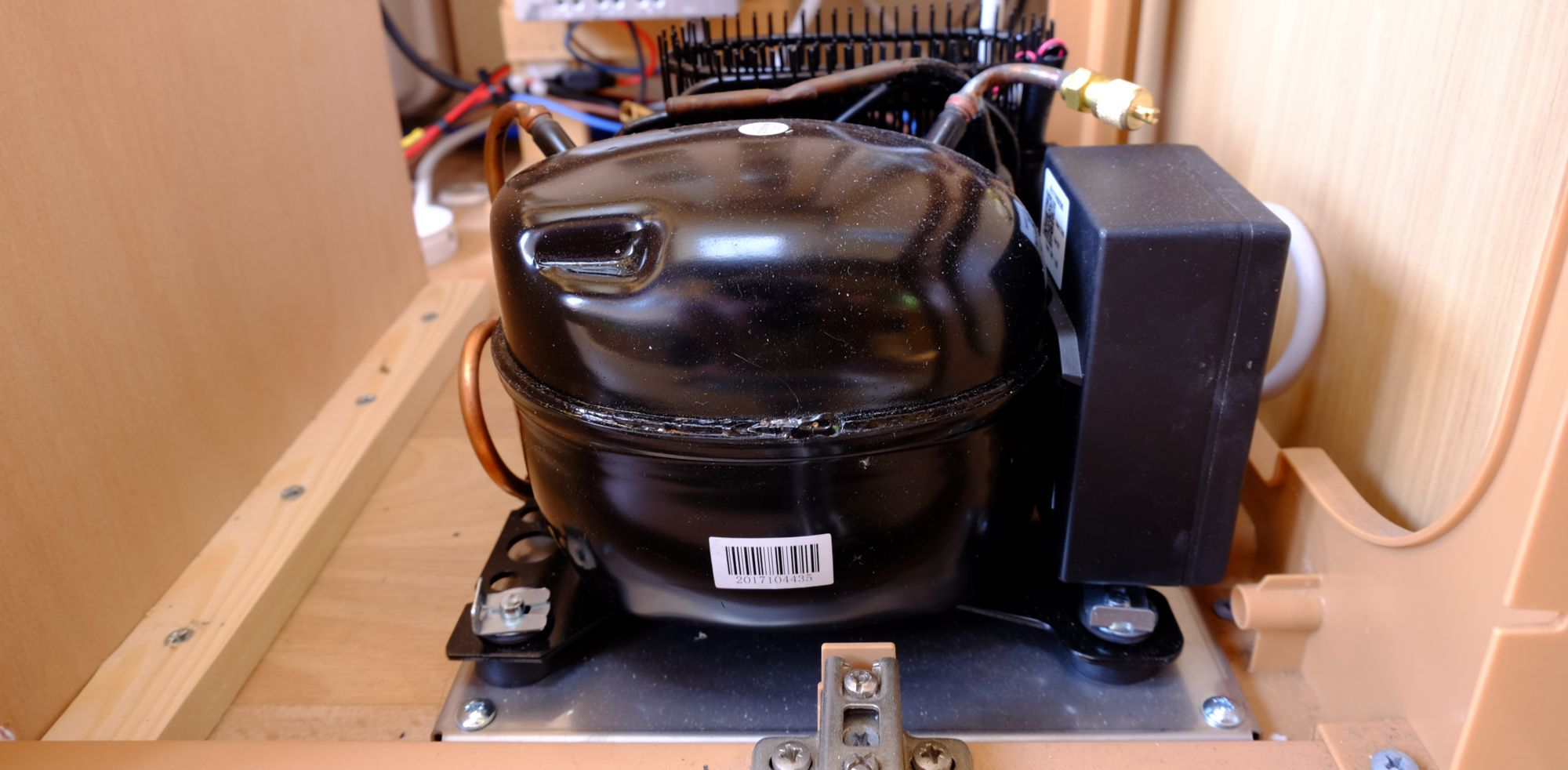 Dometic CU55 Compressor mounted under caravan bed/seating.
