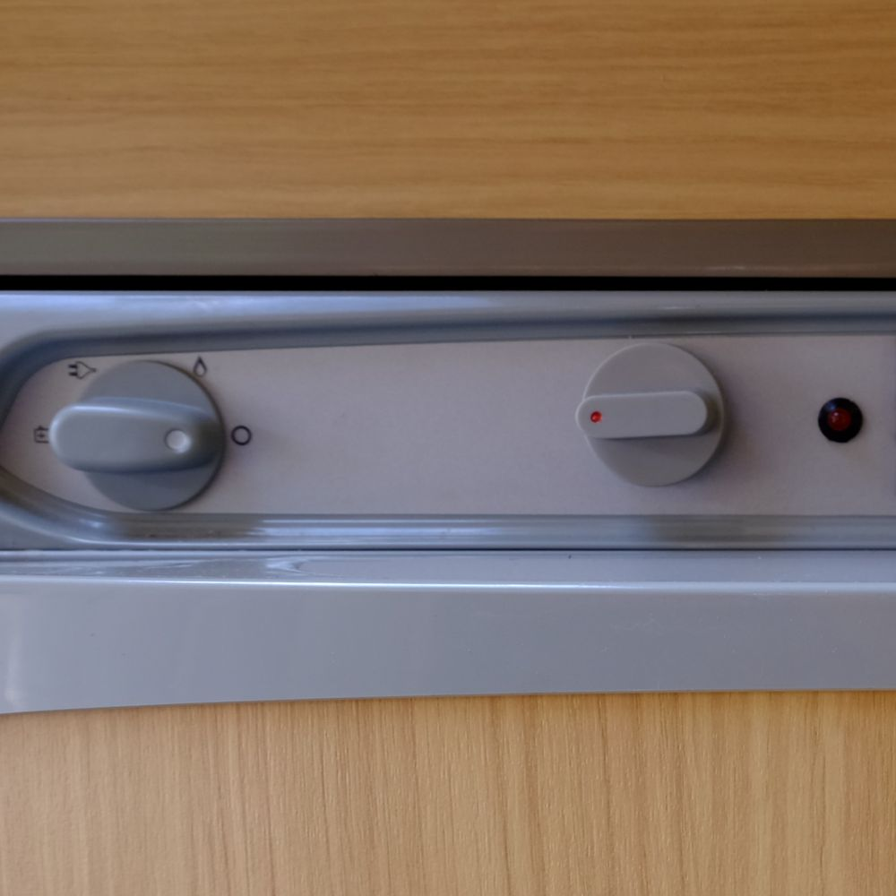 The same thermostat mounted in the fridge control panel (right of pic).