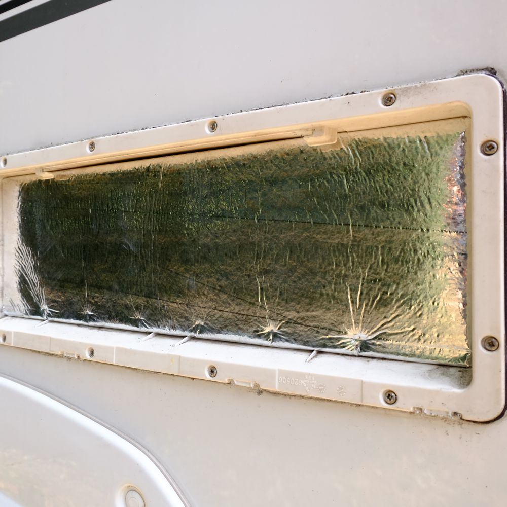 Reflective insulation under external vent (I know, it needs a clean!)